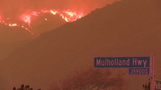 stockvideo's en b-roll-footage met five people were declared dead and 150000 evacuated friday as fierce wildfires raged across the western us state of california with one rapidly... - malibu