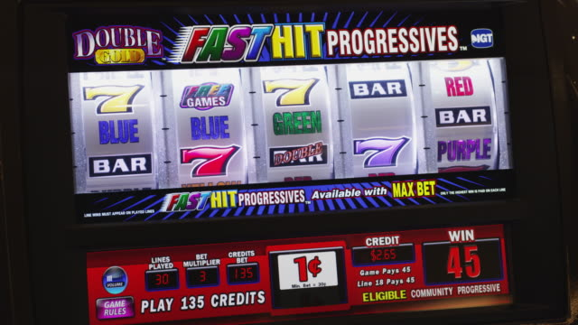 five reels spin on a gambling slot machine. - number 5 stock videos & royalty-free footage
