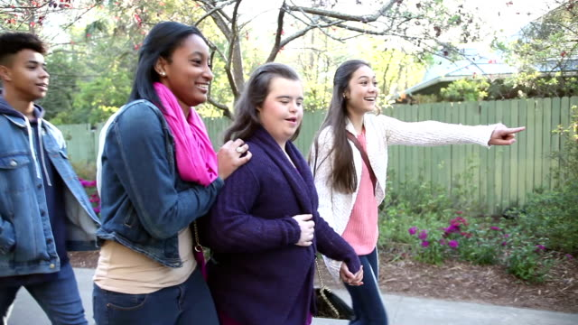 five teenagers walking in park, girl with down syndrome - 16 17 years stock videos & royalty-free footage