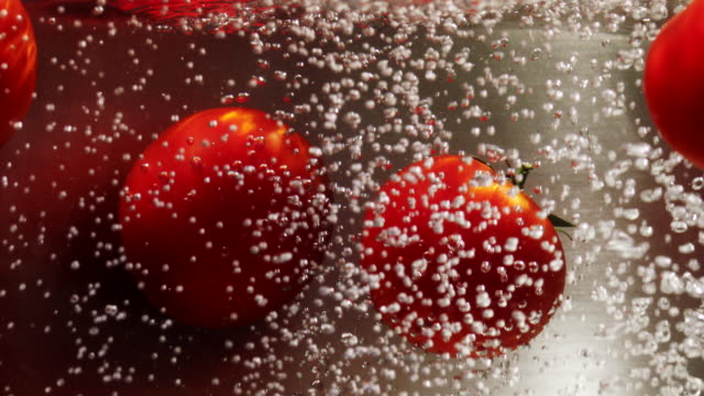 five tomatoes in boiling water - cherry tomato stock videos & royalty-free footage