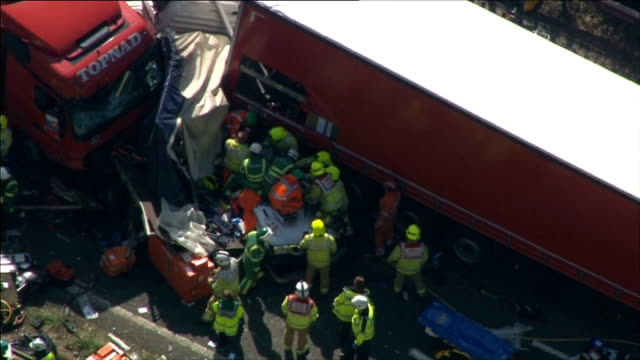 five vehicle crash on m26 in kent england kent m26 motorway emergency services at scene of multivehicle accident involving lorries cars and a van in... - emergency services vehicle stock videos and b-roll footage