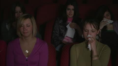 ms five women crying while watching movie, brooklyn, new york city, usa - biosalong bildbanksvideor och videomaterial från bakom kulisserna