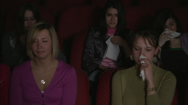 vídeos de stock, filmes e b-roll de ms five women crying while watching movie, brooklyn, new york city, usa - assoando nariz