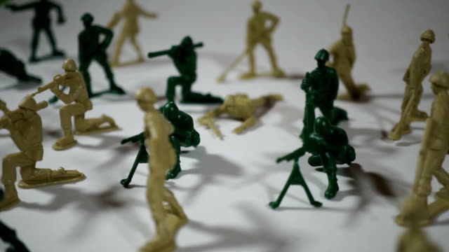 five year old boy playing with toy soldiers - figurine stock videos and b-roll footage