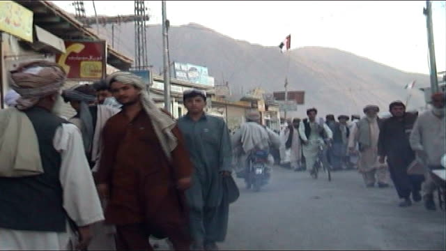 five years on since the fall of kabul to the northern alliance; pakistan: quetta: ext people along on busy streets, including men on motorcycles and... - kabul stock videos & royalty-free footage