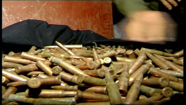 five years on since the fall of kabul to the northern alliance; man's hand rumaging through pile of bullets box of detonators man's hand placing gun... - five objects stock videos & royalty-free footage
