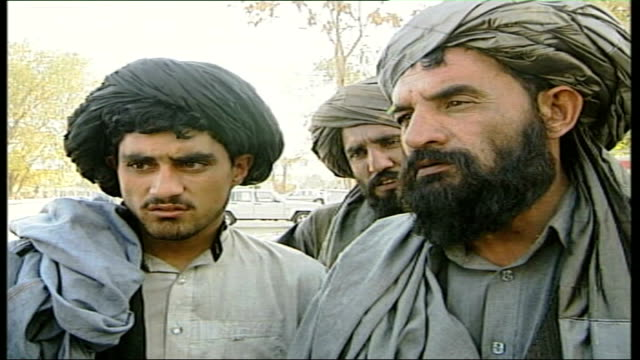 five years on since the fall of kabul to the northern alliance vox pops sot man with beard and blakc turban man with beard and grey turban - turban stock videos & royalty-free footage