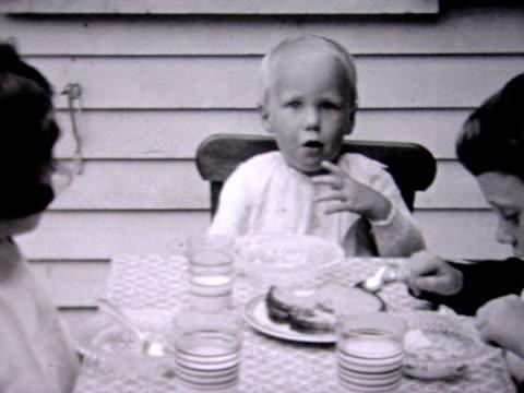 vídeos de stock e filmes b-roll de 1936 five-year old's birthday cake - avó