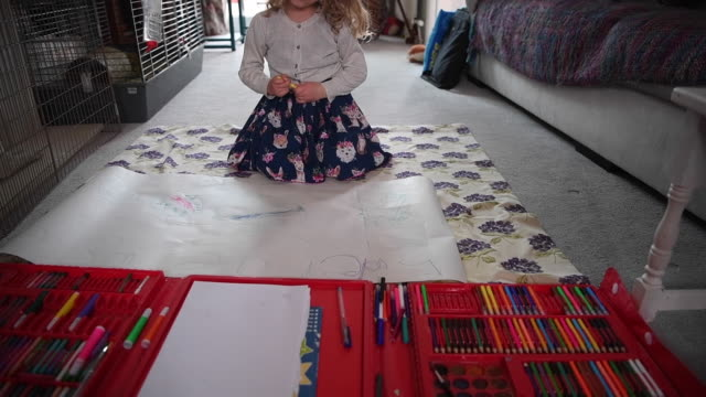 fiveyearold lois copleyjones who is the photographer's daughter does school work on the 10th day of the nationwide school closures on april 3 2020 in... - living room stock videos & royalty-free footage