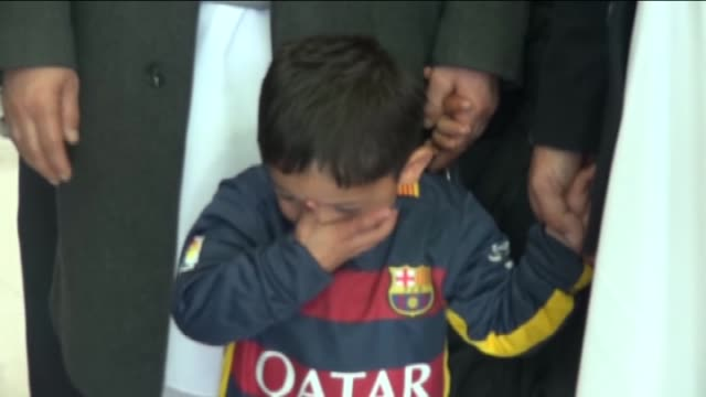 fiveyearold murtaza ahmad dressed in a striped plastic bag lionel messi jersey is seen with his relatives in kabul afghanistan on february 2 2016... - lionel messi stock videos and b-roll footage