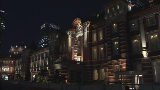 Fixed night shot of the central part of the Tokyo Station Marunouchi building night time illumination on the façade of the building
