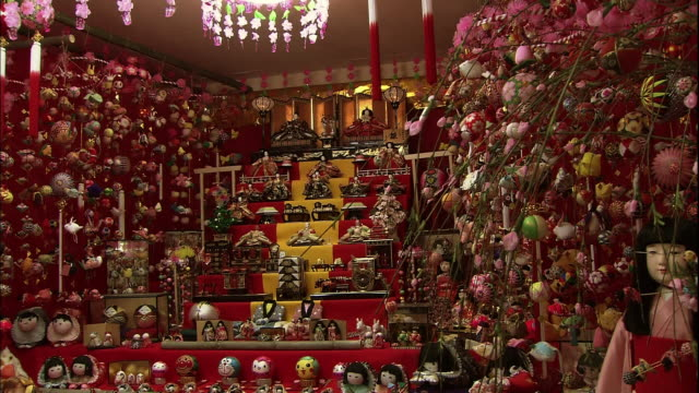 Fixed shot of gorgeous Hina Matsuri decorations and Hina Matsuri dolls on the display stairs.