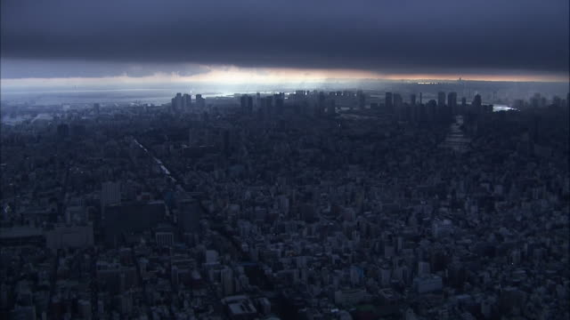 Fixed shot of huge dark nimbostratus clouds covering Tokyo at 2pm captured on remotecontrolled camera in Tokyo