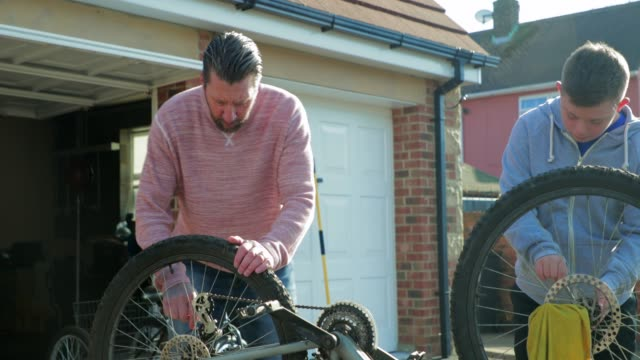 fixing a bike at home - disability services stock videos & royalty-free footage
