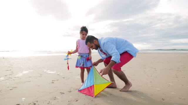 fixing a kite on the beach - kite toy stock videos and b-roll footage