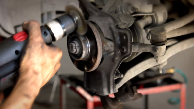 fixing the brakes - calliper stock videos and b-roll footage