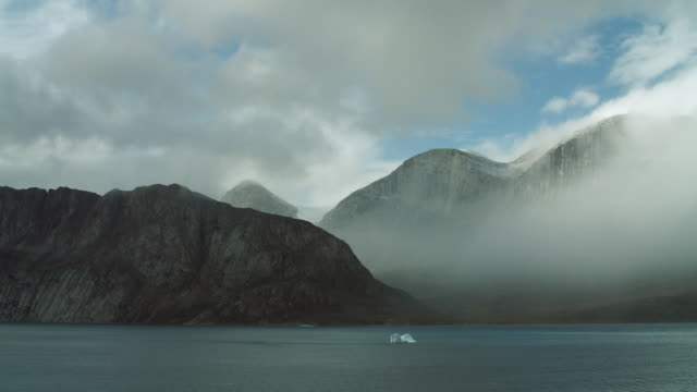 Fjord Backed By Mountains In Canada