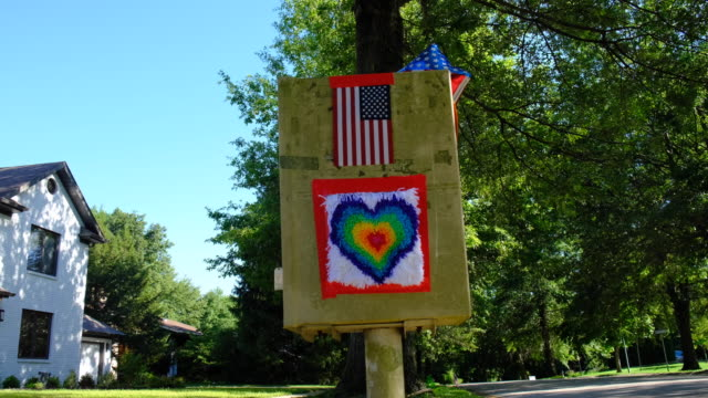 flag and heart on a mail box. bloomington, indiana, united states - : a united states post office letterbox in the hyde park neighborhood of... - time of day stock videos & royalty-free footage