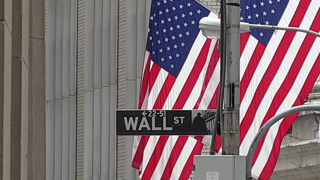 nyse, flag and wall street street sign - new york stock exchange stock videos & royalty-free footage