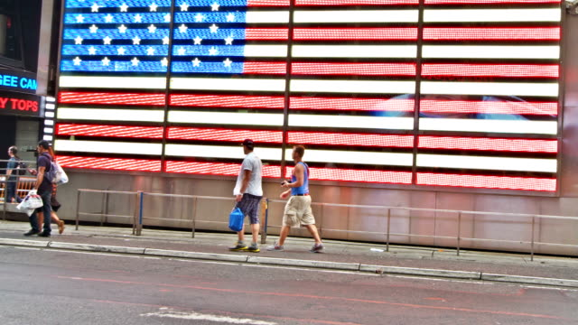 US flag background Times Square New York
