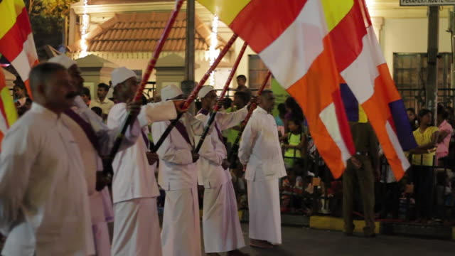 ms flag bearers parade in buddhist festival or procession 'esala perahera' (festival of tooth) audio / kandy, central province, sri lanka - sri lankan culture stock videos and b-roll footage