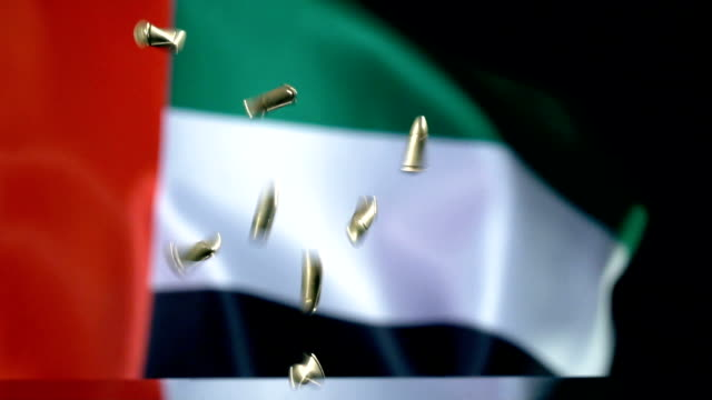 uae flag behind bullets falling in slow motion - world war one stock videos & royalty-free footage