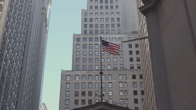 flag flies above the new york stock exchange. - federal building stock videos & royalty-free footage