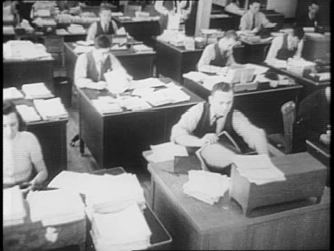flag flies above the war department building / montage of office workers typing, filing papers and doing other such labor / the door to the secretary... - 1941 stock-videos und b-roll-filmmaterial