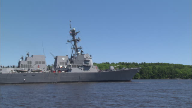 a us flag flies atop a destroyer warship. - military ship stock videos & royalty-free footage