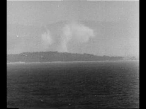 flag flies on ship in foreground as another ship approaches in background during world war ii preparation for allied invasion of sicily / coastline... - binoculars stock videos & royalty-free footage