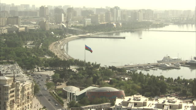 a flag flies on the coast of baku, azerbaijan. available in hd. - baku video stock e b–roll