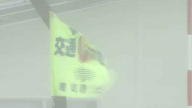 flag fluttering in blizzard, hokkaido, japan - gale stock videos & royalty-free footage