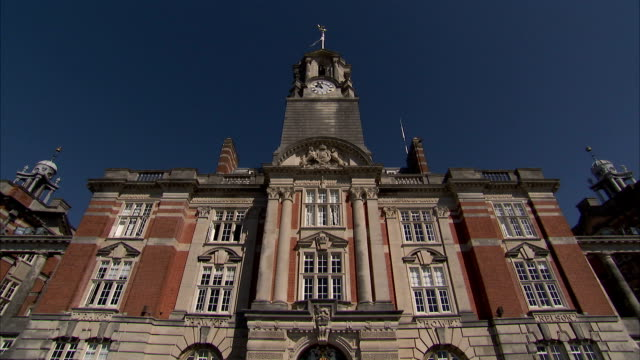 A flag flutters atop a building on the campus of Britannia Royal Naval College. Available in HD.