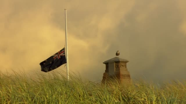 Flag flying at half mast on hill in Christchurch New Zealand after the Mosque mass shooting