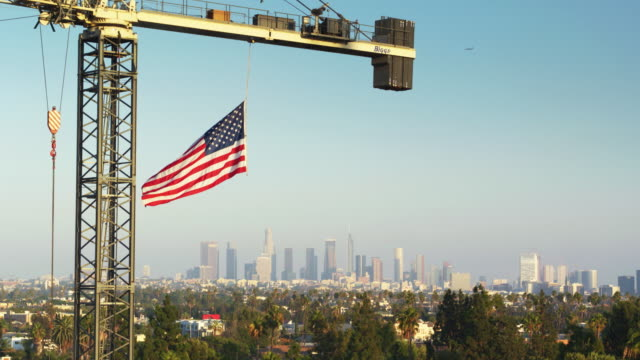 US Flag Flying from Crane with DTLA Skyline