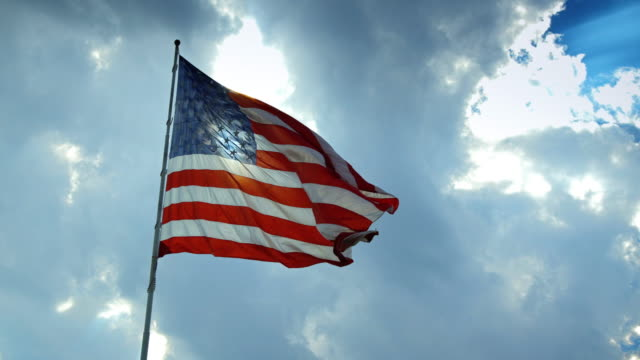 us flag flying in wind - stars and stripes stock videos & royalty-free footage