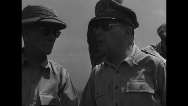us flag flying on warship / soldier on ship looking through binoculars / us general douglas macarthur with philippines president sergio osmena and... - general macarthur stock videos and b-roll footage