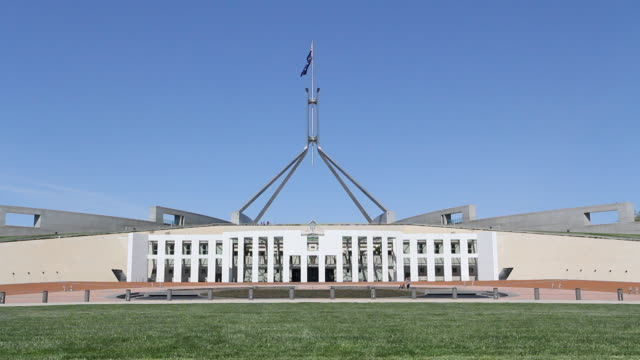 flag flying over parliament house exterior - canberra stock videos & royalty-free footage