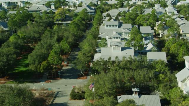 vídeos y material grabado en eventos de stock de us flag flying over seaside, florida - aerial shot - gulf coast states