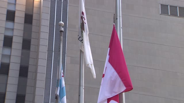 flag hangs at half mast outside of the canadian consulate at chicago's two prudential plaza after two terrorist attack in ottawa canada in oct 23 2014 - one prudential plaza stock videos & royalty-free footage