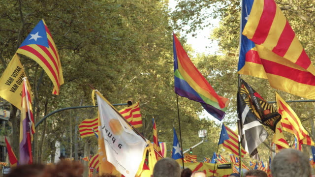 lgtbi flag in a catalonia demonstration movement for the independence from spain. barcelona during 11 september 2019 at barcelona. catalan national day - referendum stock videos & royalty-free footage