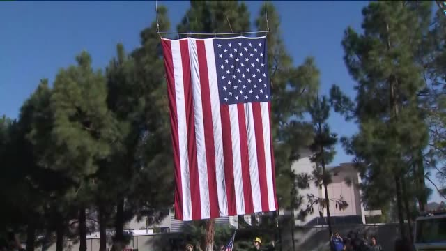 ktla a flag is raised at a procession in honor of slain sheriff's sgt ron helus who was one of the first officers to enter the southern california... - honor killing stock videos & royalty-free footage