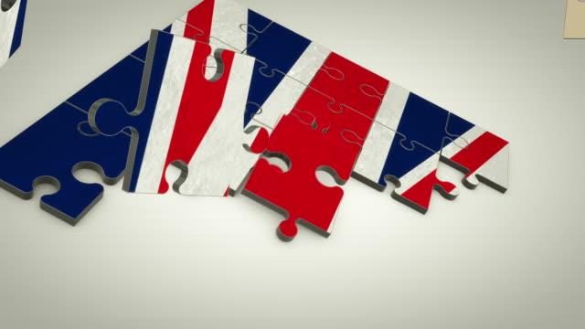 bandiera del regno unito di puzzle - bandiera inglese video stock e b–roll