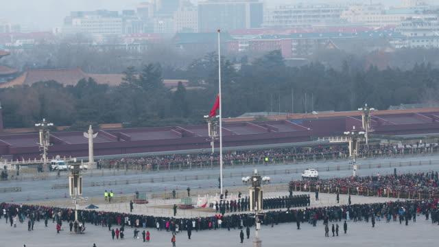 vidéos et rushes de flag lowering at tiananmen square at night,beijing - place tien an men