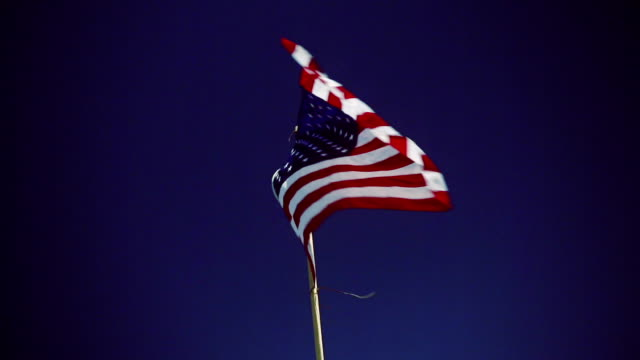 USA flag moving on the wind. Clear sky in background