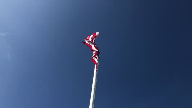 us flag moving with the wind against blue sky - american culture stock videos & royalty-free footage