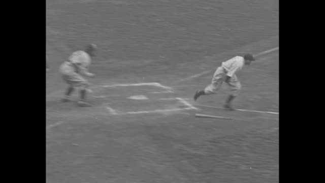 New York Yankees 1936 World Series / BREAK / baseball commissioner Kenesaw Mountain Landis in stands / Red Rolfe gets a hit heads to first / fan...