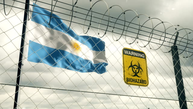 flag of argentina with biohazard sign warning of quarantine. loopable. - argentinian culture stock videos & royalty-free footage