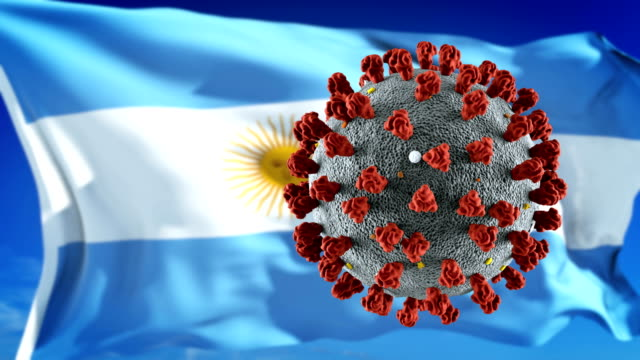 flag of argentina with outbreak deadly coronavirus covid-19. loopable - bandiera dell'argentina video stock e b–roll