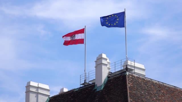 flagge von österreich und der europäischen union - austria flag stock-videos und b-roll-filmmaterial